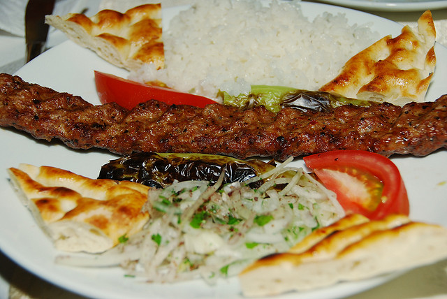 kebab with tomatoes, onions,Pide bread