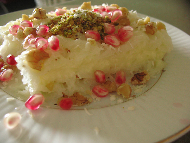 gullac topped with pomegranate and nuts